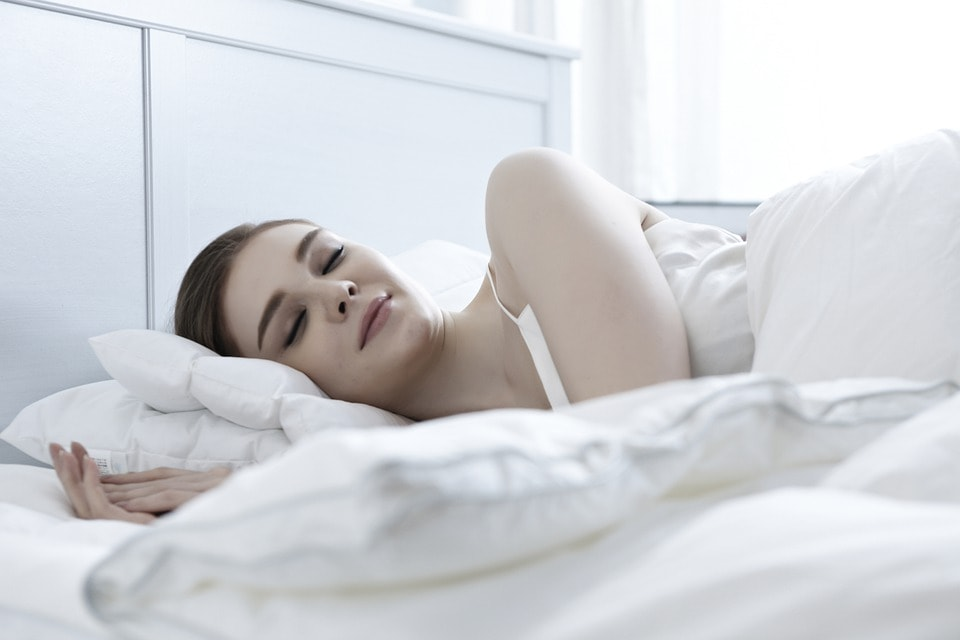 Woman sleeping at her bed