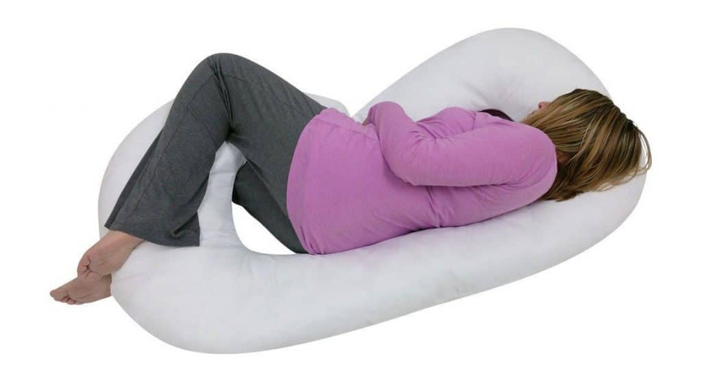 A Pregnant Woman is sleeping with J-Shaped Pregnancy Pillow