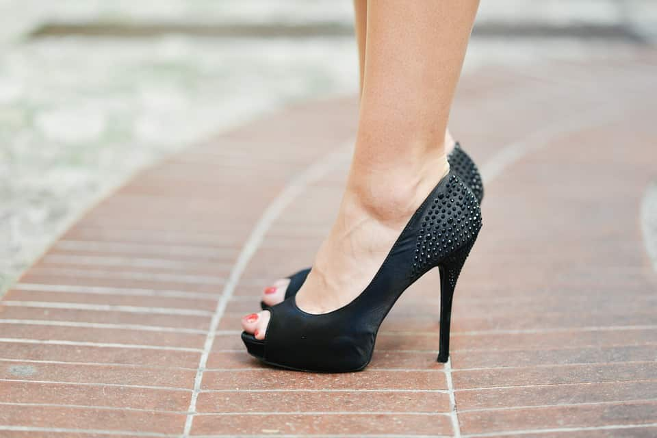 A Woman Wearing a Black High Heels During Pregnancy