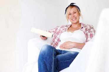 A Pregnant Woman Sitting in Newly Painted Room