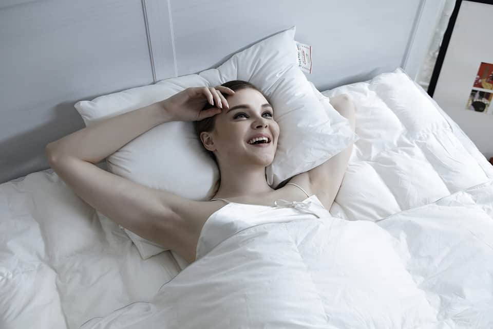 Women Smiling on Her Bed