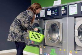 A Woman Washing the Pillow with Machine Machine